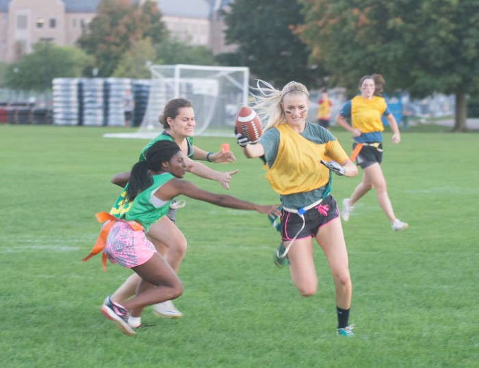 Howard Hall's defense attempts to pull the flags off a Farley player during their interhall flag football game on Tuesday.