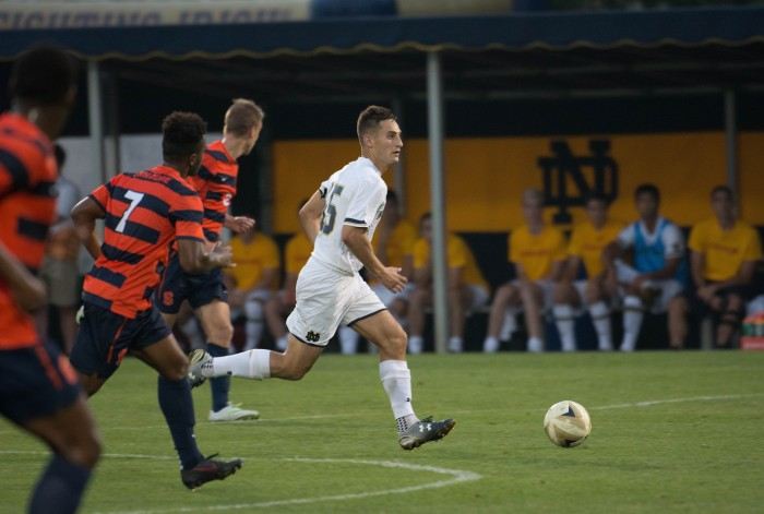 Evan Panken dribbles down the field during the Irish's 2-1 win against Syracuse on Friday.