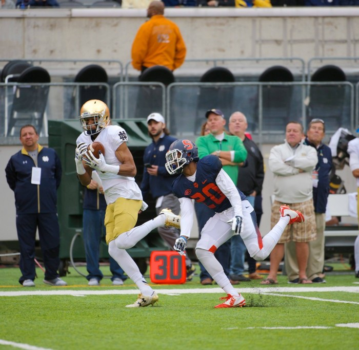 Irish sophomore receiver Equanimeous St. Brown hauls in a pass down the field during Notre Dame's 50-33 win over Syracuse on Saturday at MetLife Stadium.