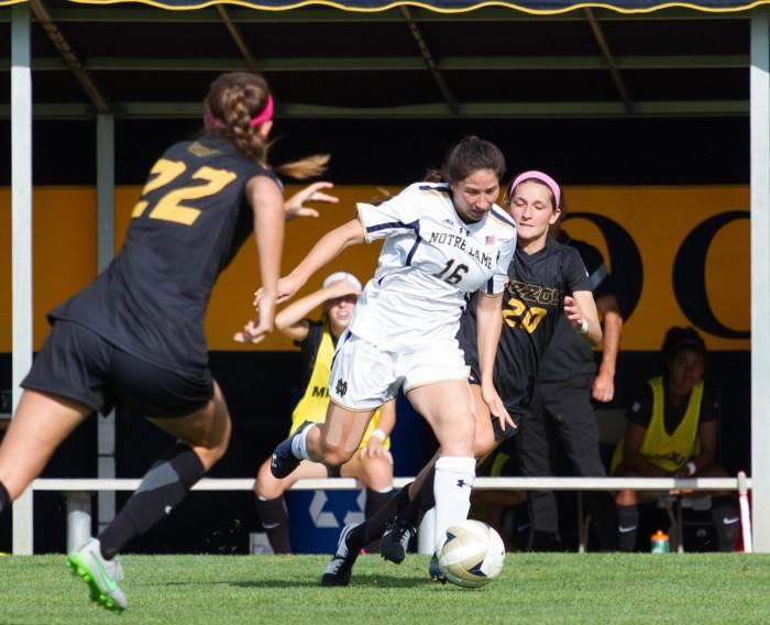 Senior Irish senior midfielder Sandra Yu muscles out a defender  during Notre Dame's 1-0 win against Missouri on Sept. 4.