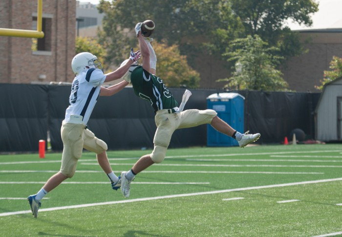 Fisher sophomore Alex Raymond makes an interception during St. Edward's 14-0 win over Fisher on Sept. 25 at LaBar Practice Complex. The interception was one of four turnovers in the game.