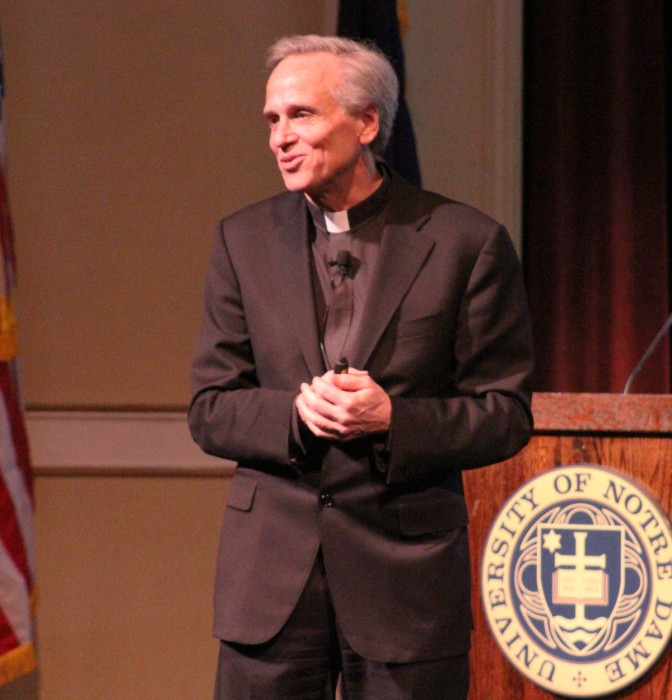 University President Fr. John Jenkins addresses members of the Notre Dame community at the fall town hall meeting Wednesday afternoon in Washington Hall.