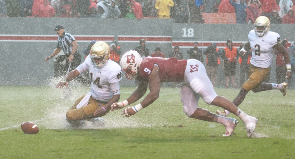 Irish junior quarterback DeShone Kizer and N.C. State junior defensive end Bradley Chubb dive for the loose ball after a miscommunication between Kizer and junior center Sam Mustipher. Kizer recovered the loose football.