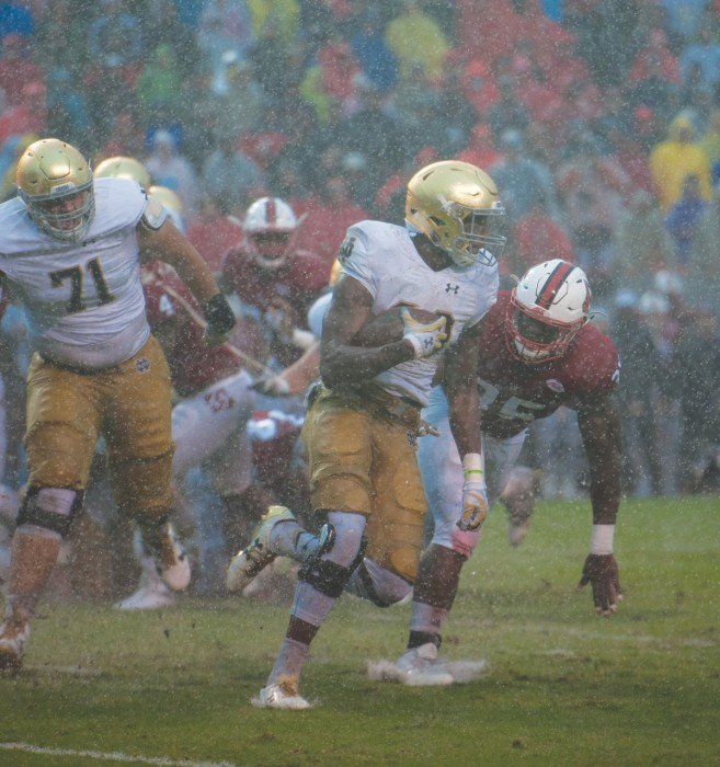 Irish sophomore running back Josh Adams runs the ball during Notre Dame's 10-3 loss to North Carolina State on Saturday. Adams rushed for 51 yards on 14 attempts to bring his season total to 391 yards.