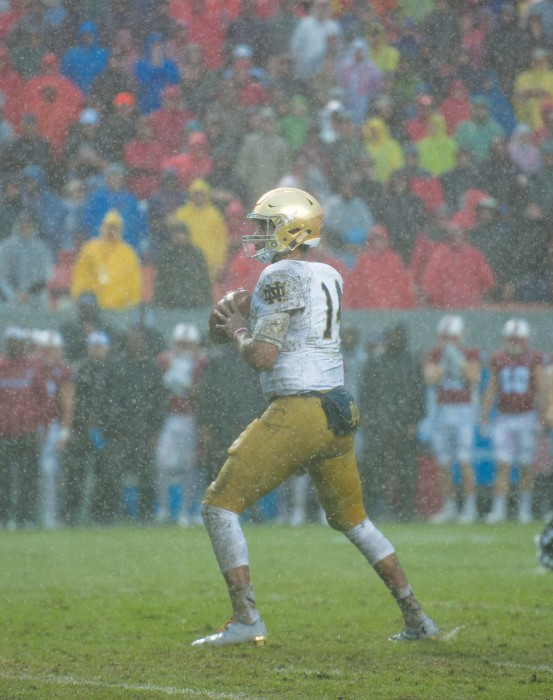 Irish junior quarterback DeShone Kizer looks down the field during Notre Dame's 10-3 loss to North Carolina State on Saturday.