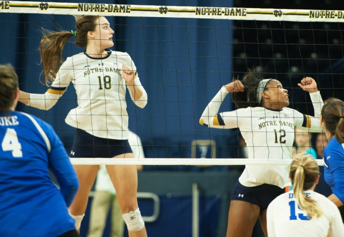 Senior Katie Higgins and freshman Jemma Yeadon prepare to block a spike during Notre Dame's 3-1 victory over Duke on Sept. 30.