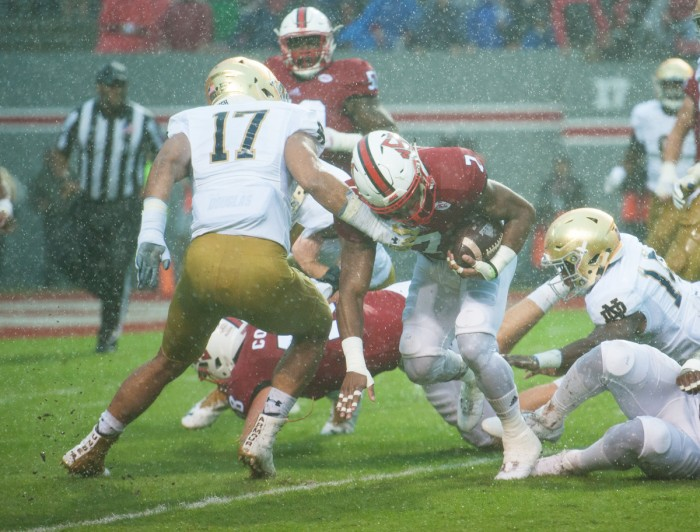 Senior linebacker James Onwualu gets set to make a tackle in Notre Dame's 10-3 loss to North Carolina State on Saturday.
