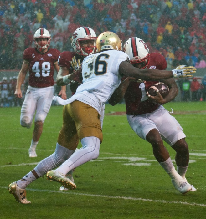 Irish senior corner back Cole Luke wraps up the ball carrier in Notre Dame's 10-3 loss to North Carolina State.