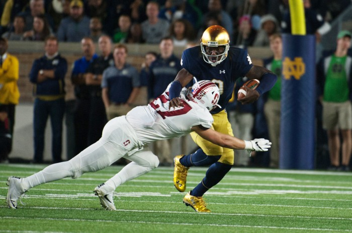 Senior Irish quarterback Malik Zaire is tackled by a Stanford defender in Notre Dame's 17-10 loss to the Cardinal on Saturday.