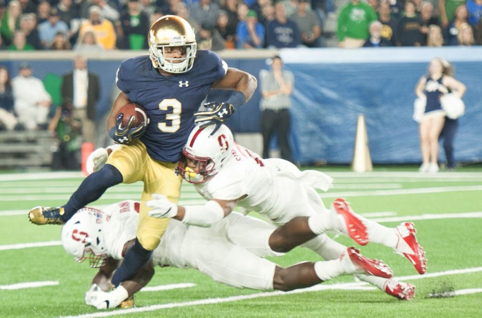 Irish sophomore wide receiver C.J. Sanders attempts to avoid getting tripped up by defenders in Notre Dame's 17-10 loss to Stanford on Oct. 15. Sanders returned one punt and one kickoff in the game.
