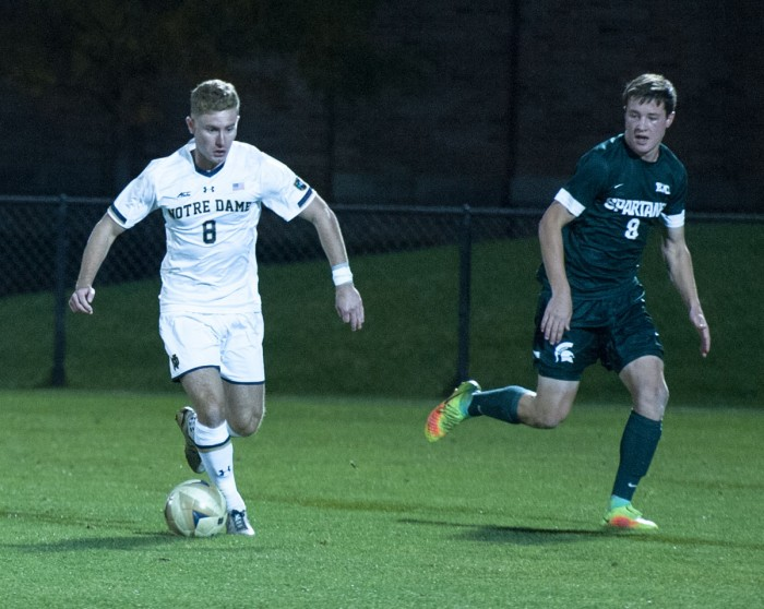 Irish junior forward Jon Gallagher dribbles the ball in Notre Dame's 1-0 loss to Michigan State on Tuesday at Alumni Stadium.