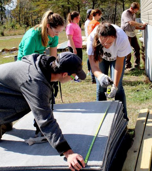 Notre Dame students help with home repairs while working for the Christian Appalachia Project. The students spent their fall break in Kentucky as part of the Center for Social Concerns seminar.