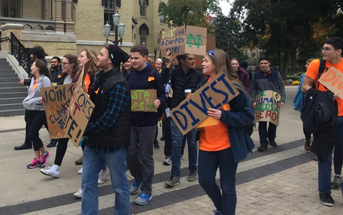 Led by sophomore Adam Wiechman, students in Fossil Free ND march in protest to the Dome.