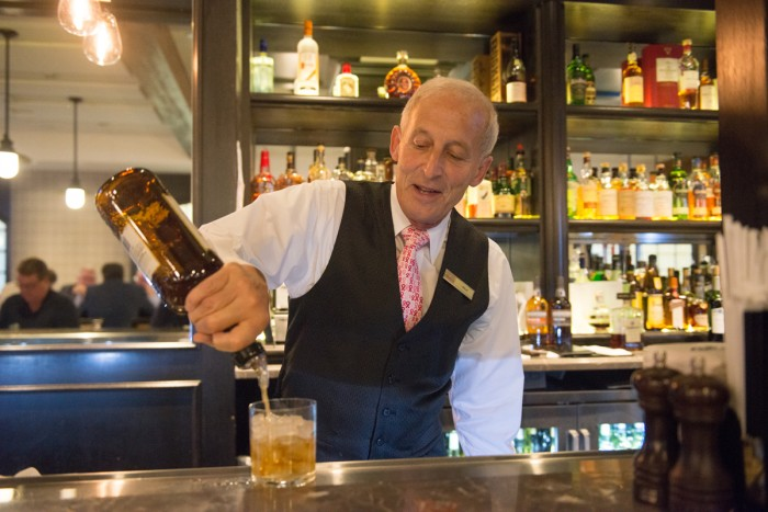 "Patrick ""Murf"" Murphy tends the bar at Rohr's. He has worked at the Morris Inn since he was 15 years old."