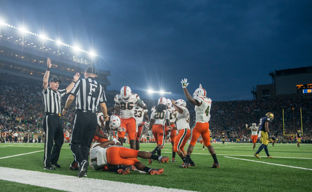 The Miami punt coverage unit celebrates scoring a go-ahead touchdown after Irish sophomore receiver C.J. Sanders, right, muffed a punt that rolled into the end zone. The recovery put the Hurricanes up 27-20.