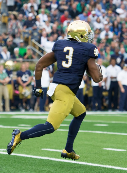 Irish sophomore C.J. Sanders returns a kick during Notre Dame's 30-27 win over Miami on Saturday.