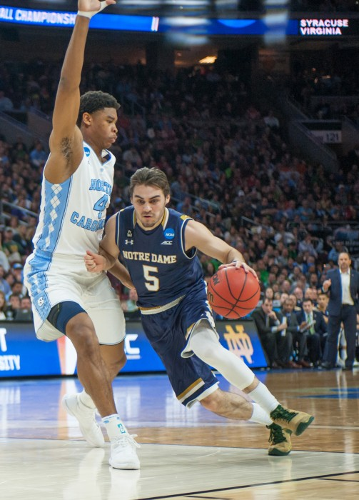 Junior guard Matt Farrell drives into the paint during Notre Dame's 88-74 loss to North Carolina on March 27 in the Elite Eight at Wells Fargo Center.
