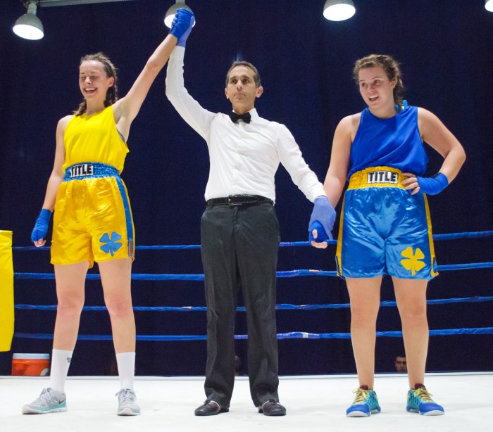 A referee raises class of 2016 alumna Maggie Adams' arm in victory after her bout with senior Isabella Bianco at the 2015 Baraka Bouts.