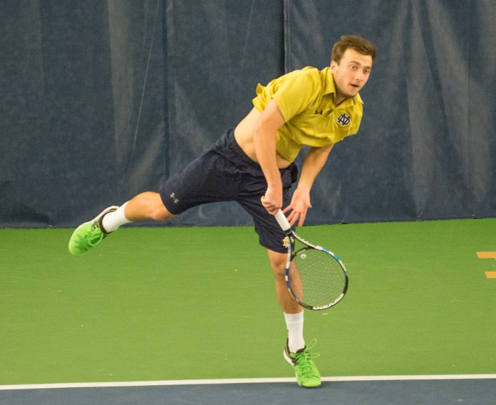 Irish senior Eddy Covalschi fires a shot over the net during Notre Dame's 5-2 win over Duke on March 18 at Eck Tennis Pavilion.