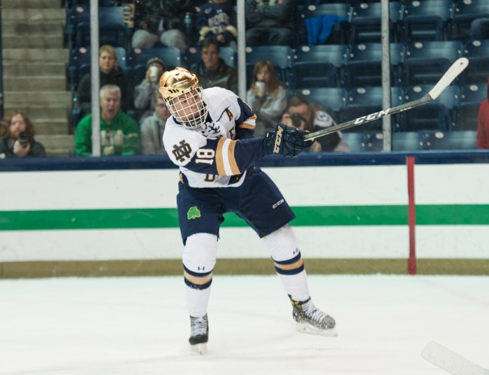 Irish junior forward Jake Evans sends the puck flying in Notre Dame's 4-2 loss to UConn on Oct. 27 at Compton Family Ice Arena.