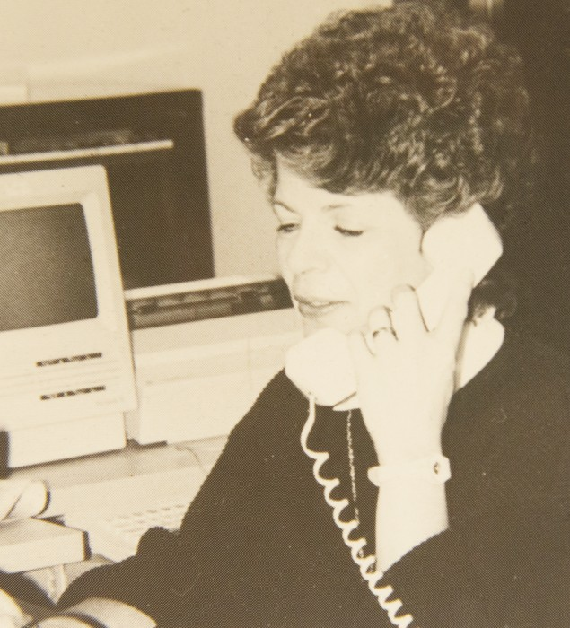 Shirley Grauel answers a phone call in this photo from the Observer's 35th anniversary issue. Grauel worked for the Observer for 30 years.
