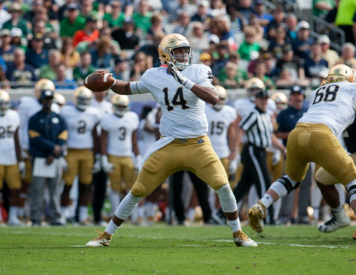 Junior quarterback DeShone Kizer drops back to pass during Notre Dame's 28-27 loss to Navy. Kizer threw for 223 yards and three touchdowns on the game.