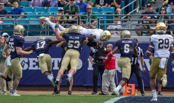 Irish sophomore receiver Eqaunimeous St. Brown flips into the end zone during Notre Dame's 28-27 loss to Navy on Saturday in Jacksonville. St. Brown had 62 receiving and one touchdown on the day.