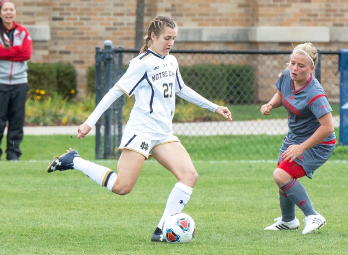 Notre Dame senior forward Kaleigh Olmsted winds up to kick during a 1-0 Irish win over North Carolina State on Oct. 30 at Alumni Stadium.