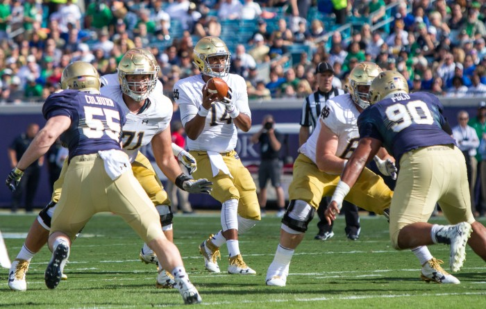 DeShone Kizer receives snap as he begins to look downfield.