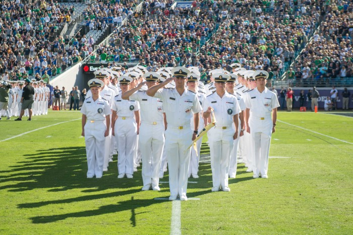 Midshipmen of Hotel Company participate in the opening procession of student attendees to the game.