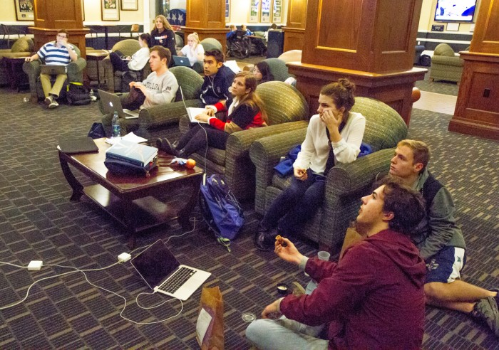 Students anxiously watch the election results on the TV in the lobby of LaFortune Student Center on Tuesday.