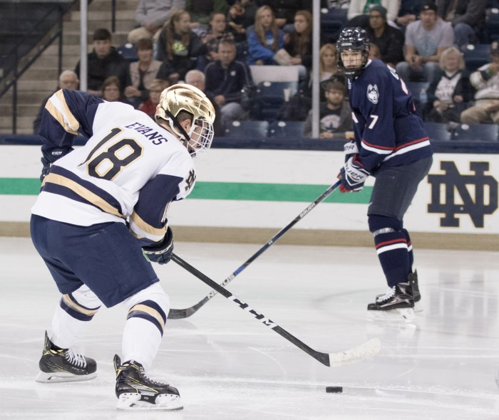 Irish junior forward Jake Evans looks to move the puck during Notre Dame's 4-2 loss against UConn on Oct. 27 at Compton Family Ice Arena.