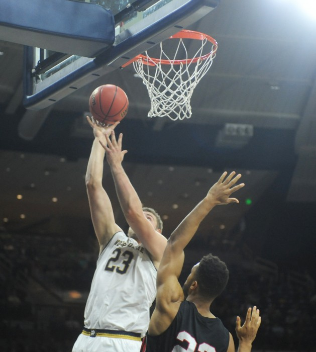 Irish junior forward Martinas Geben looks to convert a layup over a defender during Notre Dame's 103-48 win over Catholic on Nov. 7. Geben made five shots on five attempts and blocked five shots during the game.