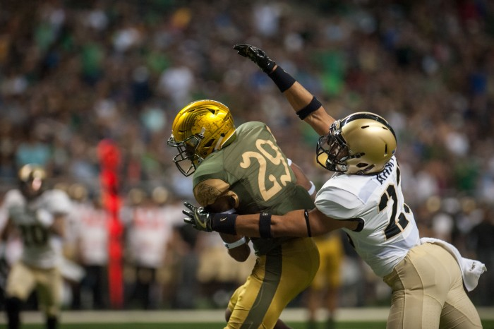 Irish freshman receiver Kevin Stepherson hauls in a touchdown reception during Notre Dame's 44-6 win at the Alamodome on Saturday.