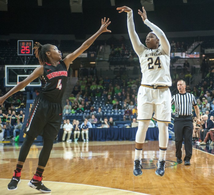 Irish sophomore guard Arike Ogunbowale fires a shot from the three-point line in Notre Dame's 129-50 win over Roberts Wesleyan on Nov. 3.