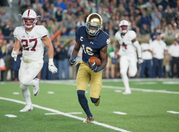 Irish senior receiver Torii Hunter Jr. looks to pick up more yards after a catch during Notre Dame's 17-10 loss to Stanford on Oct. 15.