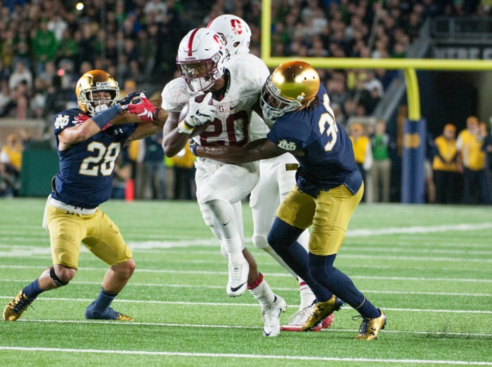 Irish senior cornerback Cole Luke wraps up Stanford sophomore running back Bryce Love during Notre Dame's loss to Stanford on Oct. 15. Luke had two interceptions when the Irish played Stanford in 2014.