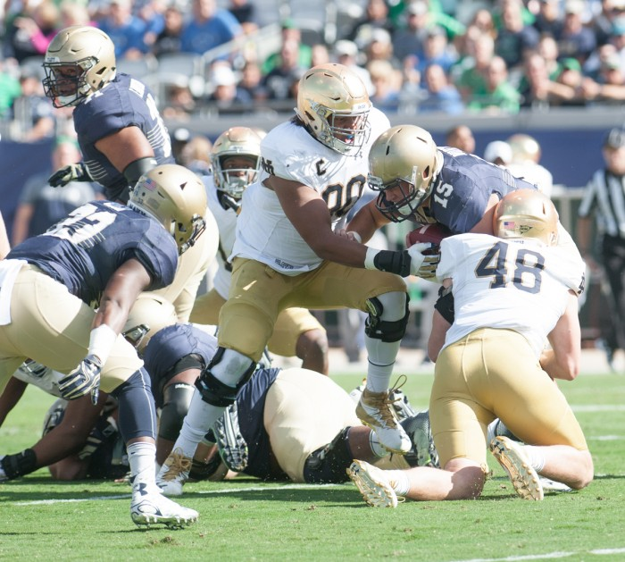 Irish senior lineman Isaac Rochell tackles the Navy quarterback during Notre Dame's 28-27 loss to the Midshipmen on Nov. 5.