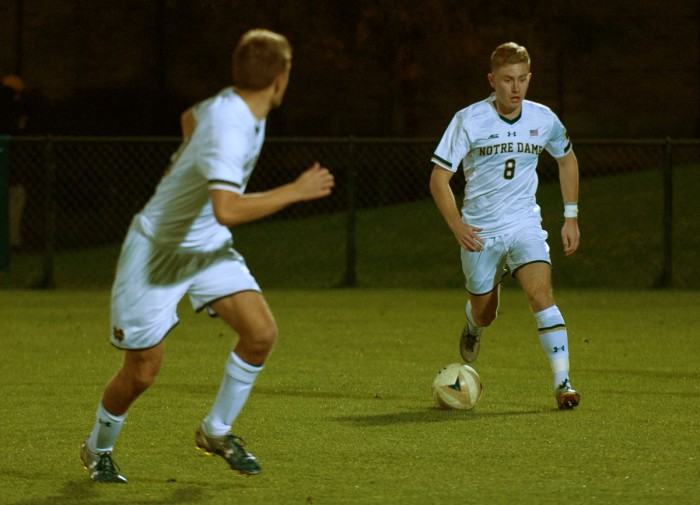 Junior forward Jon Gallagher dribbles upfield during Notre Dame's 1-0 loss to Michigan State on Oct. 25 at Alumni Stadium.