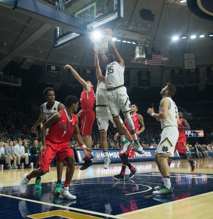 Junior captain Bonzie Colson goes up for the put-back dunk against Seattle on Wednesday at Purcell Pavilion. Colson and fellow captain V.J. Beachem each had 16 points in the 92-49 Irish win.