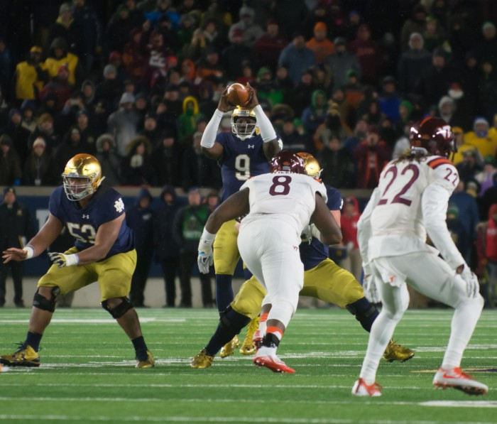 Irish senior quarterback Malik Zaire catches the snap in the final seconds of Notre Dame's 34-31 loss to Virginia Tech on Saturday.