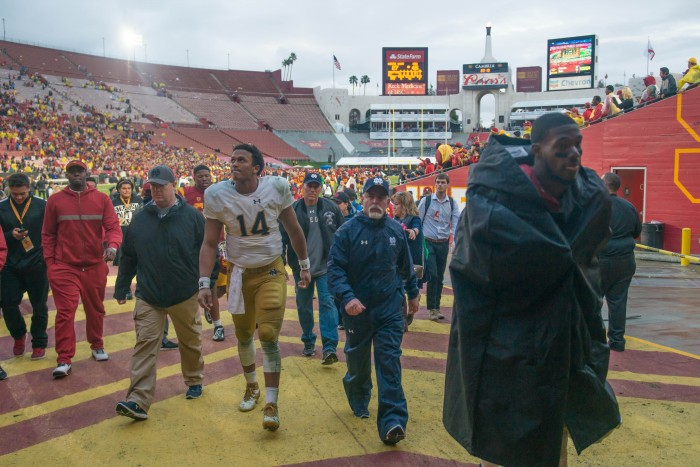 Junior quarterback DeShone Kizer walks off the field following the Irish loss to USC.