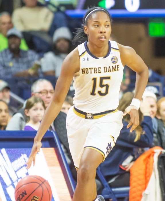Irish senior guard Lindsay Allen dribbles up the court during the team's 71-60 win against Washington at Purcell Pavilion on Nov. 20. Against Louisiana-Lafayette. she recorded her 1,000th career point, and she posted her 600th career assist against TCU.