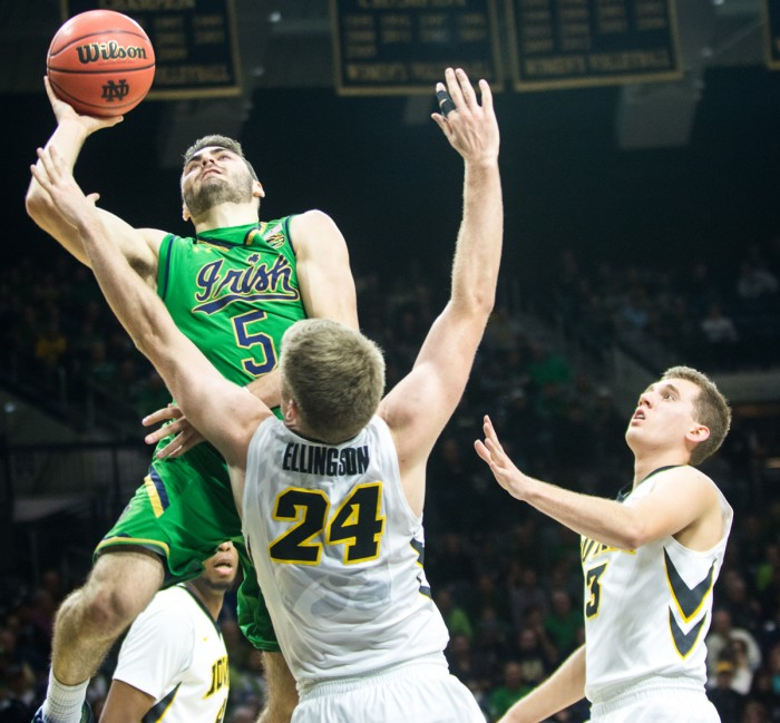 Irish junior guard Matt Farrell jumps into a defender during Notre Dame's 92-78 victory over Iowa on Tuesday night at Purcell Pavilion. Farrell had 16 points and seven assists in the contest.