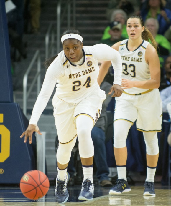 Irish sophomore guard Arike Ogunbowale dribbles the ball up the court during Notre Dame's 71-60 win over Washington on Nov. 20 at Purcell Pavilion.