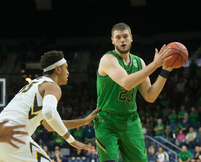 Irish junior forward Martinas Geben looks to pass during Notre Dame's 92-78 win over Iowa on Tuesday at Purcell Pavilion.