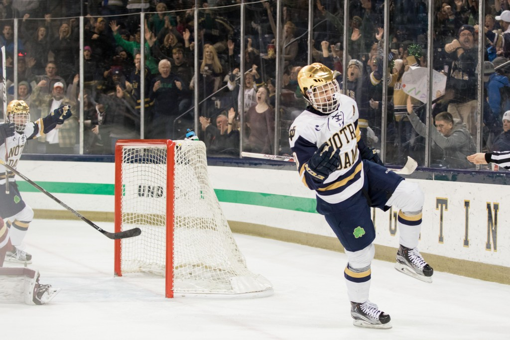 Irish junior forward Anders Bjork celebrates his game-winning goal in the second period of No. 14 Notre Dame's 3-2 upset of rival No. 4 Boston College at Compton Family Ice Arena on Saturday night.