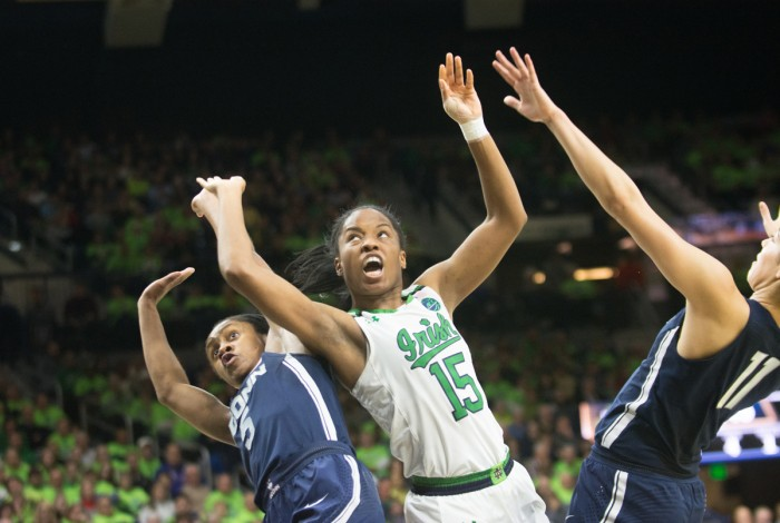 Irish senior guard Lindsay Allen fights through contact to go up for a layup during Notre Dame's 72-61 loss to UConn on Dec. 7 at Purcell Pavilion.