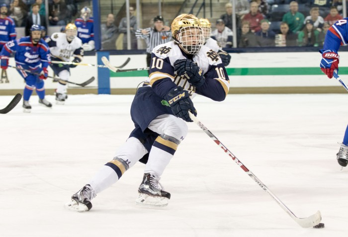 Irish junior forward Anders Bjork skates up the ice with the puck during Notre Dame's 4-1 loss to UMass Lowell on Nov. 17 at Compton Family Ice Arena.