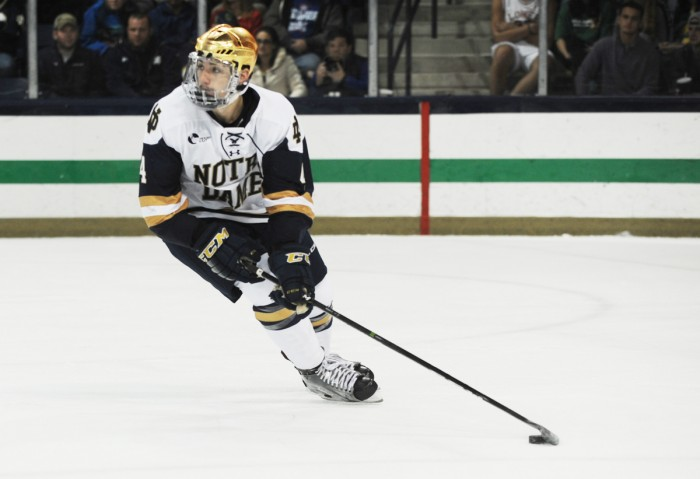 Sophomore defenseman Dennis Gilbert surveys the ice during Notre Dame's 4-1 victory over UMass Lowell on Nov. 18 at Compton Family Ice Arena.